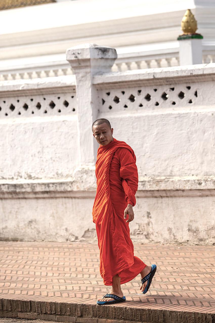 Monk in saffron robe in Luang Prabang, Laos
