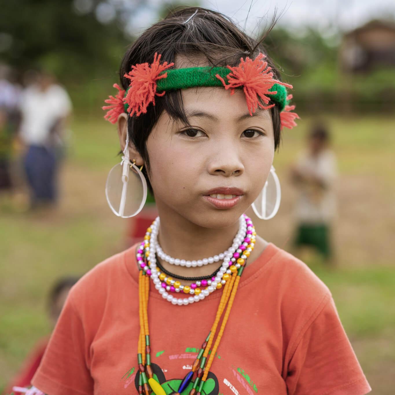 Girl in traditional Naga costume near Homalin, Myanmar
