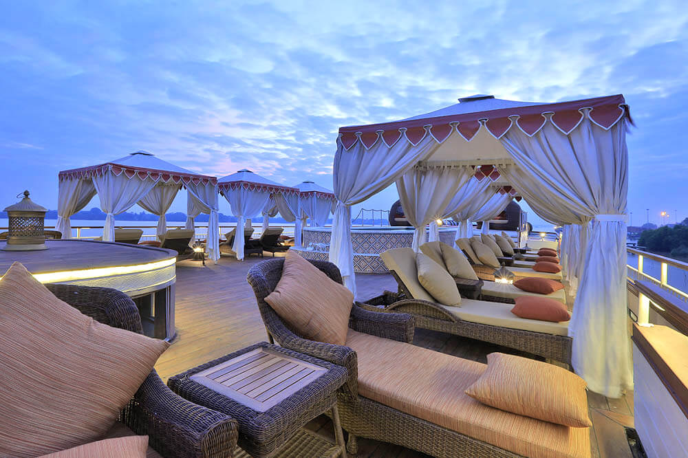 The lavish Anawrahta sun deck with pool, loungers and shaded cabanas
