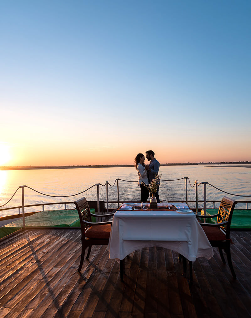 Celebrate with a private and romantic dinner on Anawrahta's sun deck