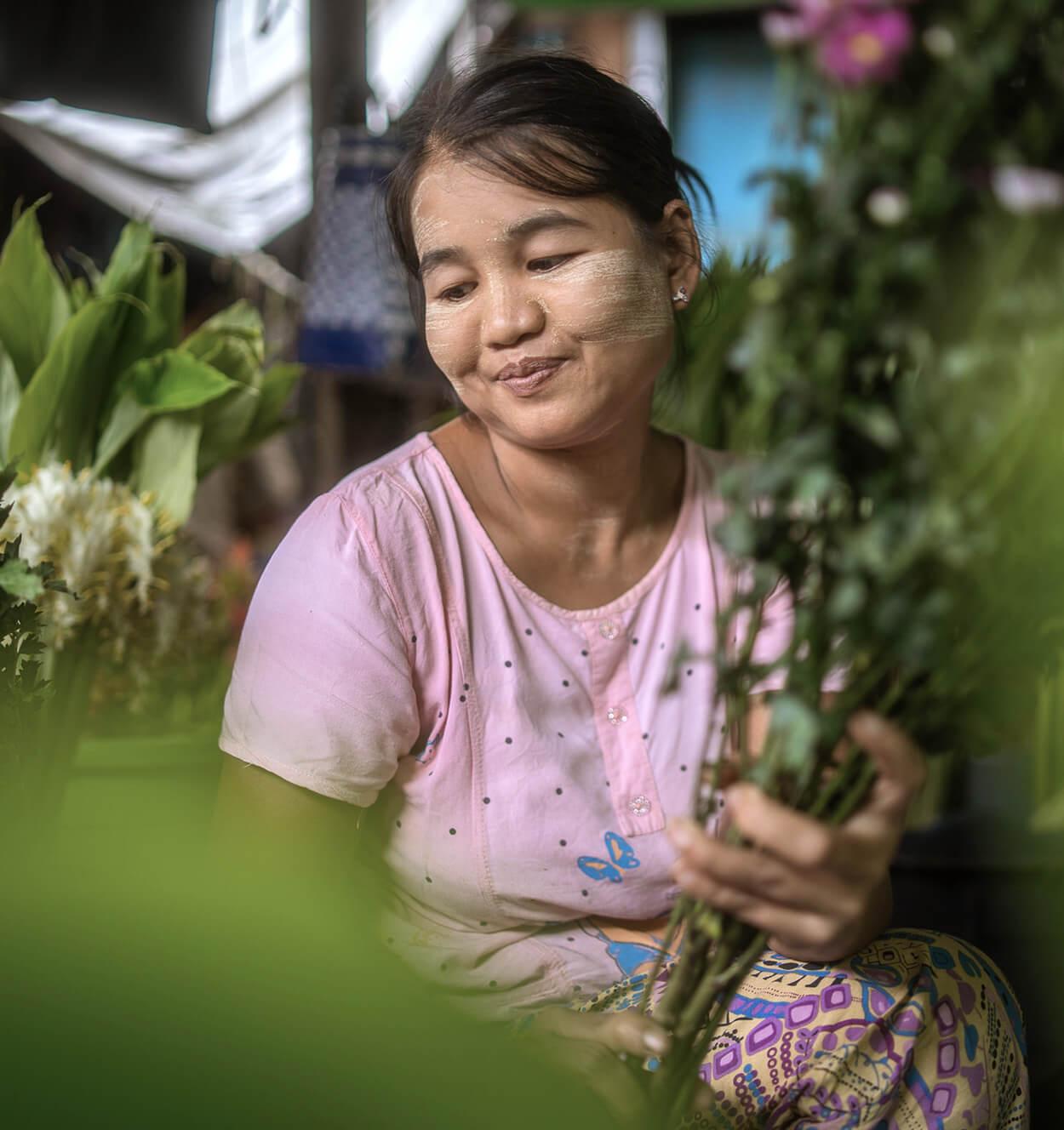 A flower vendor at a local Burmese market