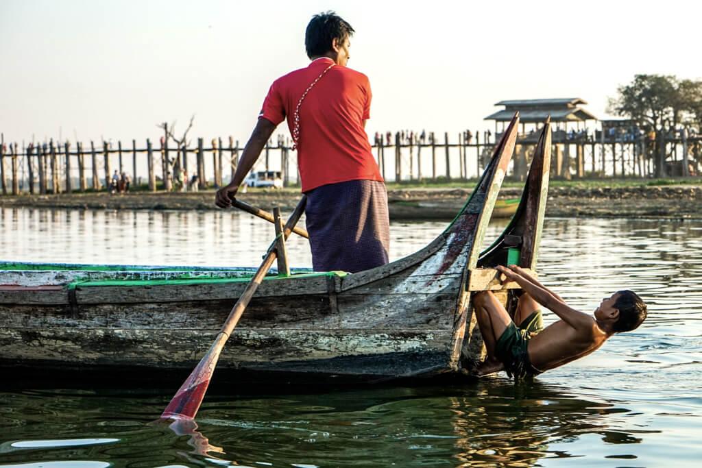 A Burmese child goes for a swim at U Bein Bridge in Amarapura, Myanmar