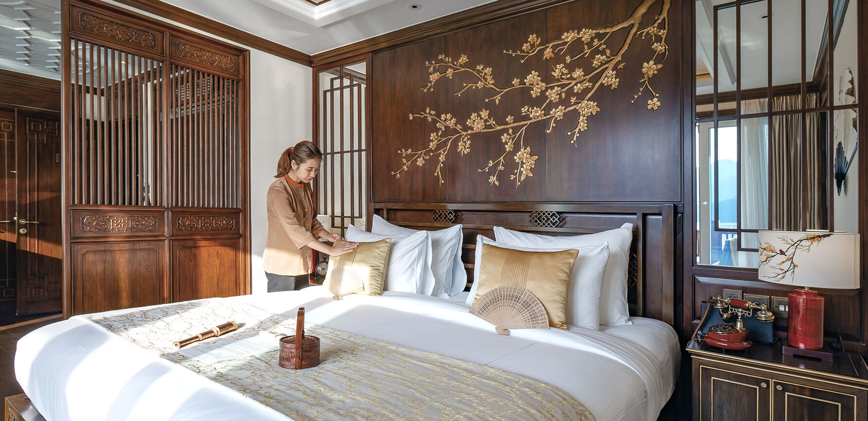 Housekeeping freshens up a Heritage Line Ylang Signature Suite