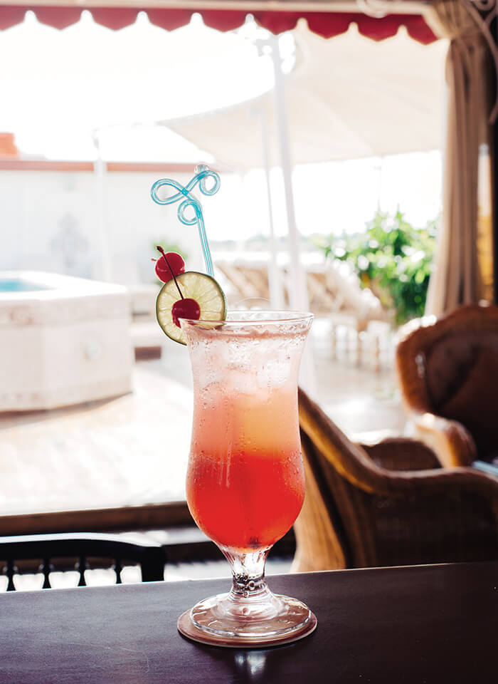 A refreshing signature cocktail served aboard The Jahan's East India Club & Bar