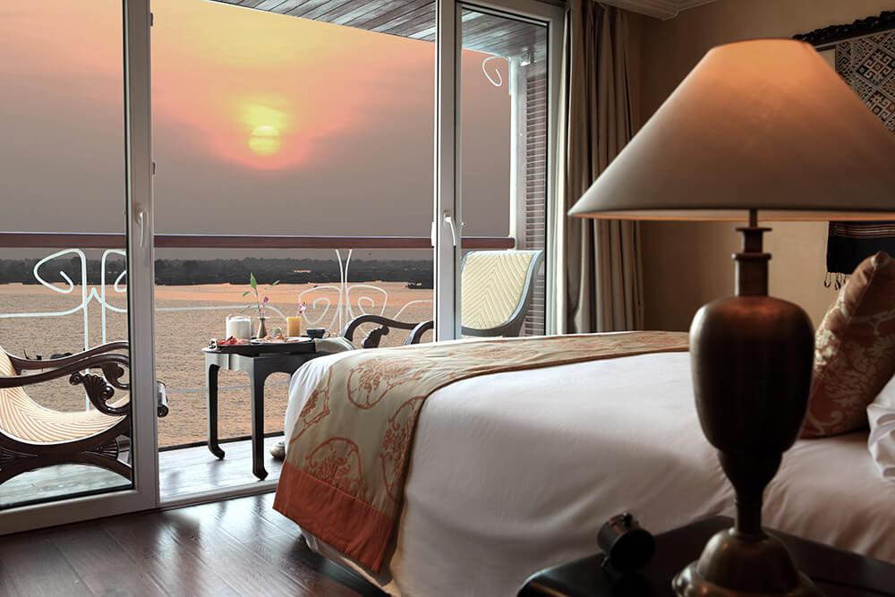A magnificent sunrise breakfast on the balcony of a Deluxe Room aboard Jayavarman