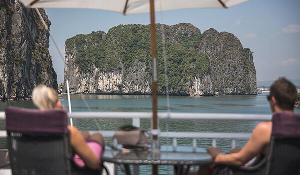 Passengers aboard Heritage Line Jasmine enjoying the view of Halong Bay