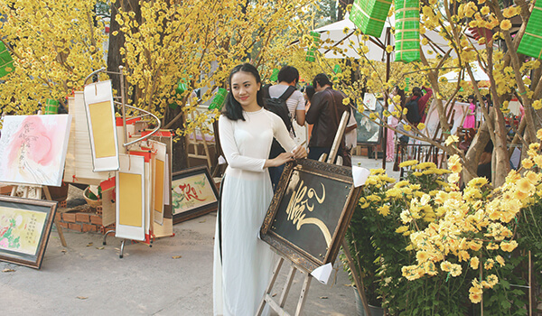 Young Vietnamese woman in traditional Ao Dai