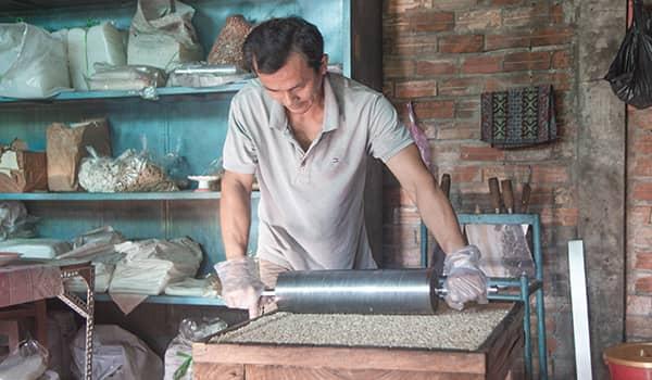 Worker flattens pop rice in the Mekong delta