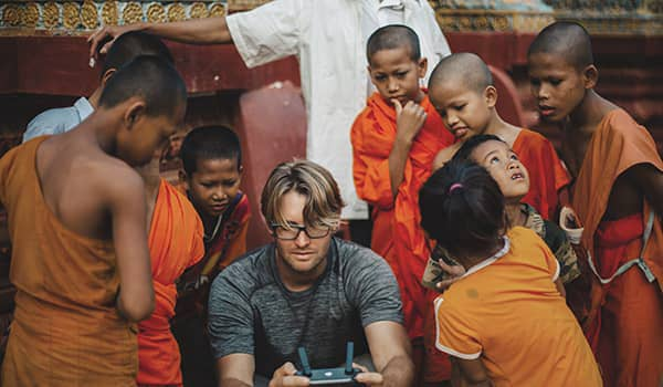 Novice monks at Wat Hanchey in awe of a visitor and his drone