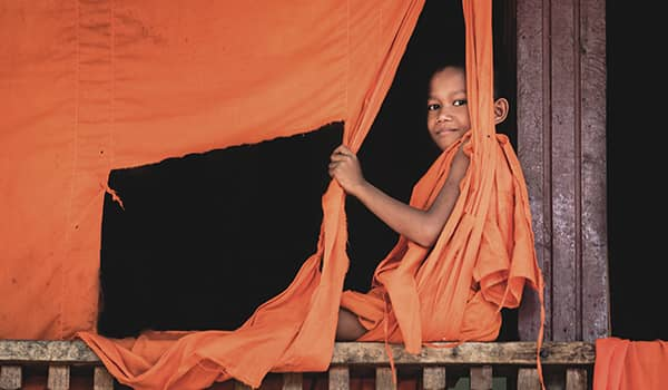 Novice monk at Wat Hanchey Temple in Kampong Cham, Cambodia