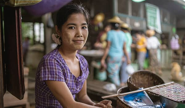 Local Burmese woman wearing Thanaka