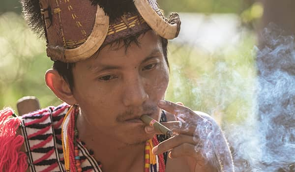 Man from Naga tribe smoking Burmese Cheroot cigar