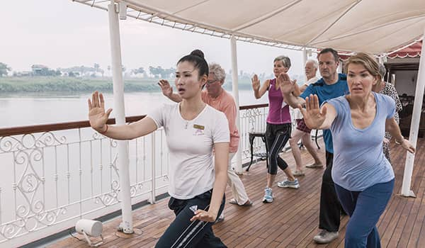 Tai chi aboard Heritage Line The Jahan on a Mekong River cruise