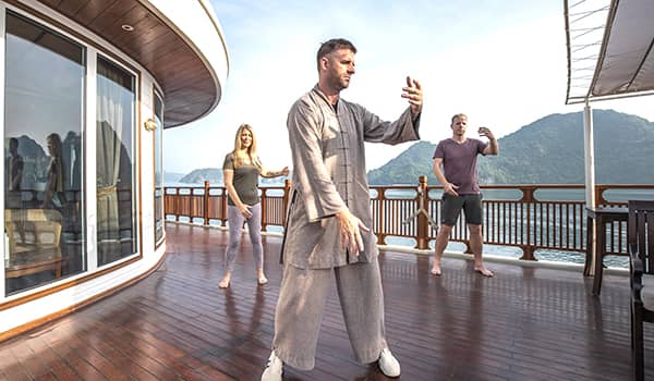 Tai chi aboard Heritage Line Ylang on a Lan Ha Bay cruise